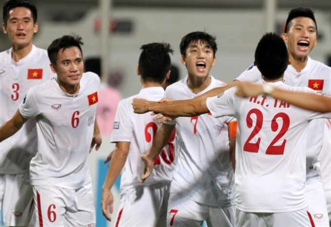 Việt Nam celebrate winning Bahrain 1-0 at the Asian Football  Confederation s U19 Championship on October 23. — Photo the-afc.com aa1f7b025ede1