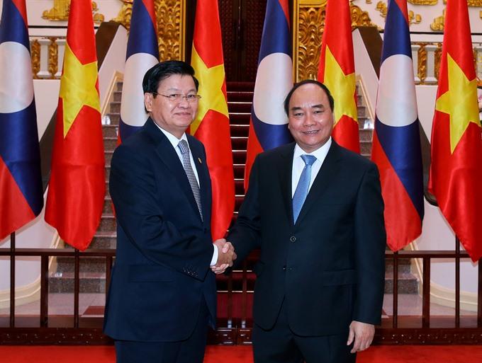 Vietnamese Lao Prime Ministers meet in Hà Nội
