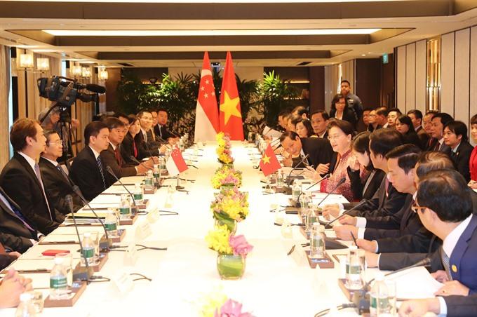 Top legislator hails Singaporean firms cooperation initiatives