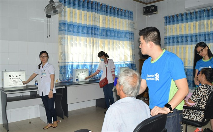 Standard Chartered holds free eye care camp