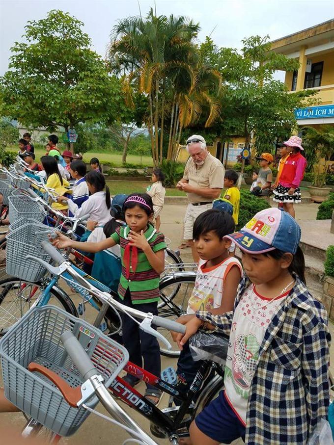 Charities provide scholarships bikes for VN kids