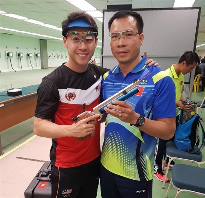 Olympian Vinh wins regional shooting champs