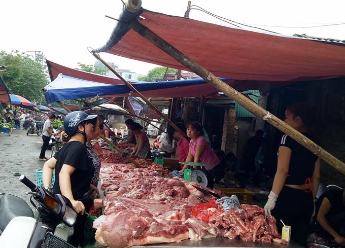 Firms promote pork demand farmers struggle