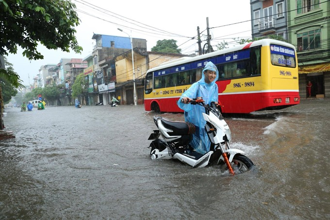 Photo essay: Hà Nội submerged by torrential rain