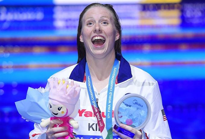 King breaks womens 100m breaststroke record