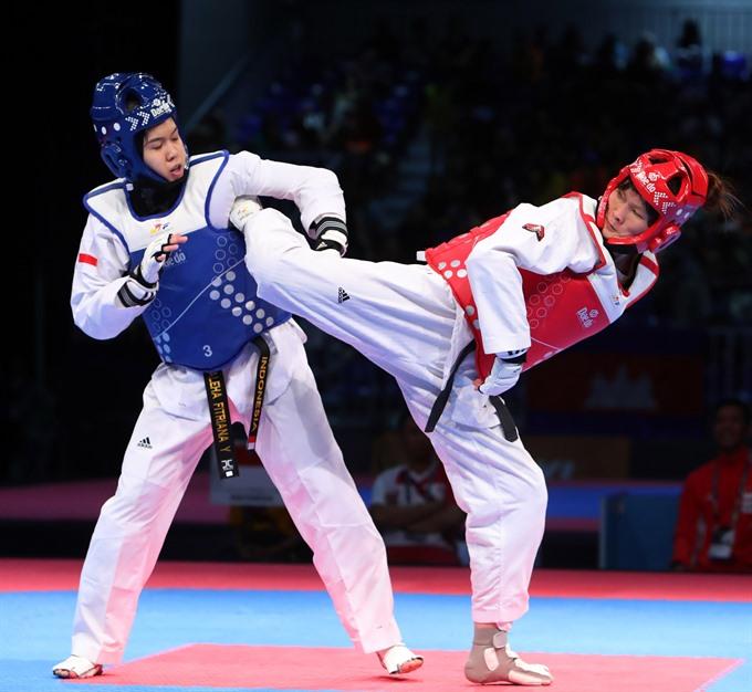 Martial artists claim gold medals for Việt Nam