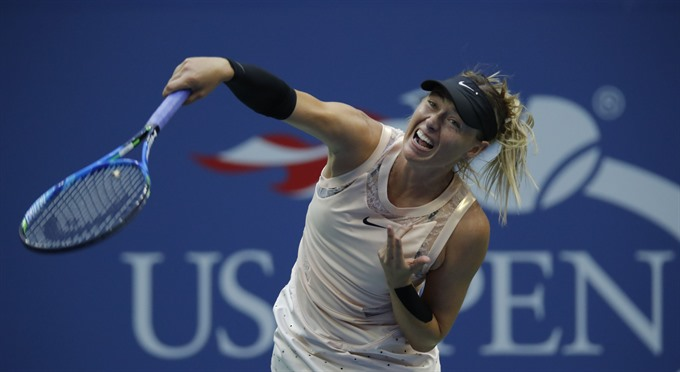 Sharapova return picks up steam with US Open last-32 spot