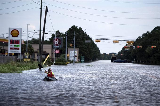 Texas flood toll mounts amid chemical blast fears