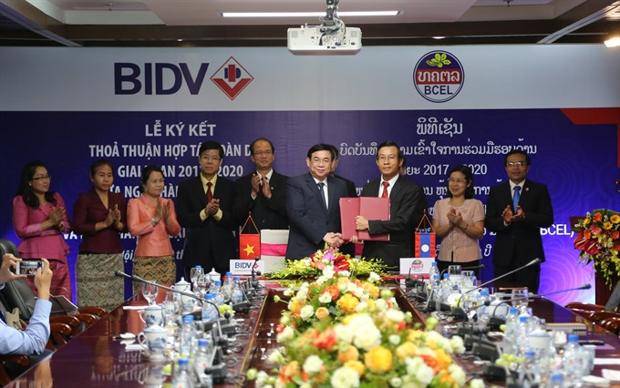 Bidv lao foreign trade bank beef up cooperation economy for Banque pour le commerce exterieur lao public