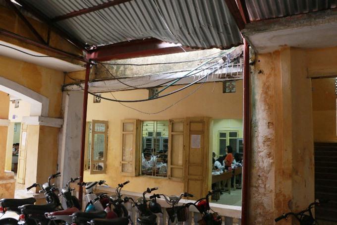 School roof collapse haunts parents students