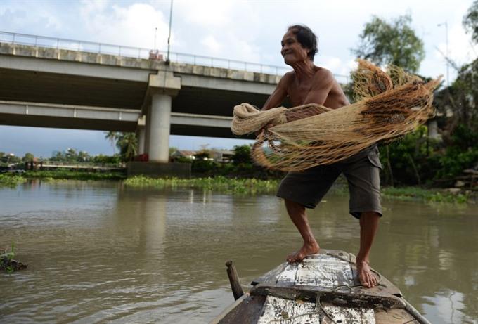 A true fisher of men on the Sài Gòn River