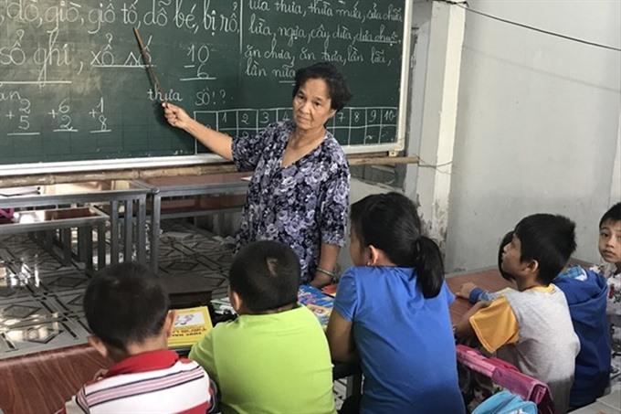 Elderly teacher keeps going