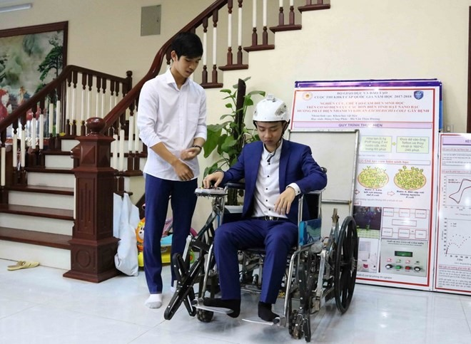 Young students make head motion wheelchairs practical