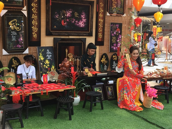 Traditional calligraphy markets open for Tết