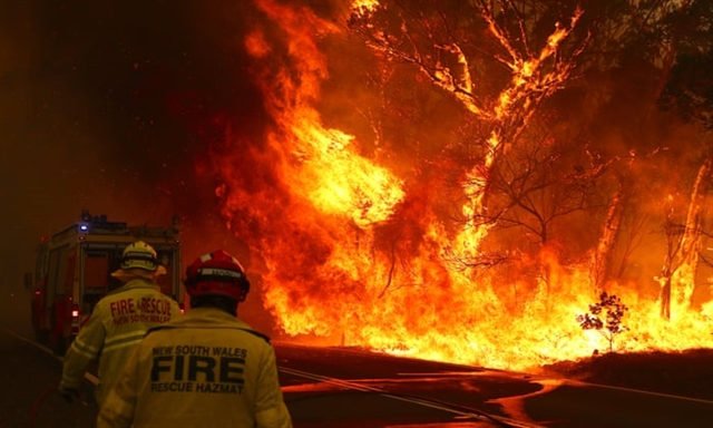 Australian PM ends holiday to face fire crisis