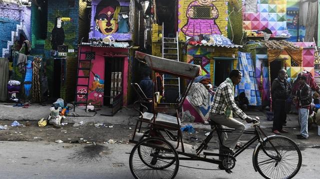 Rainbow murals bring some cheer to Delhi slum