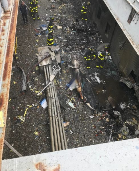 One dead as helicopter crash-lands on Manhattan building