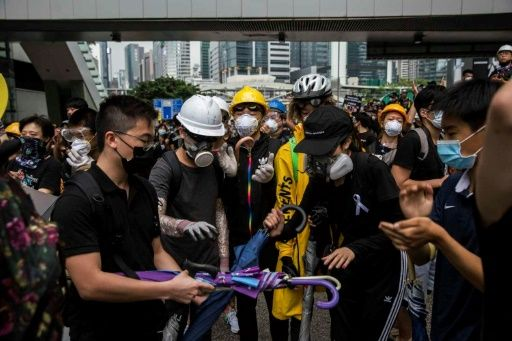 Protesters control key roads after historic Hong Kong rally