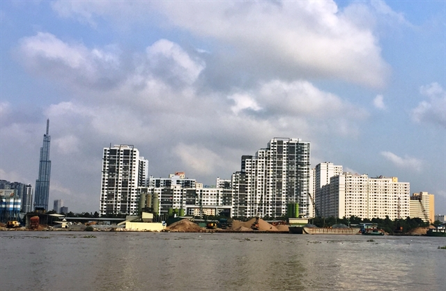 Two HCM City districts join battle with illegal sand miners