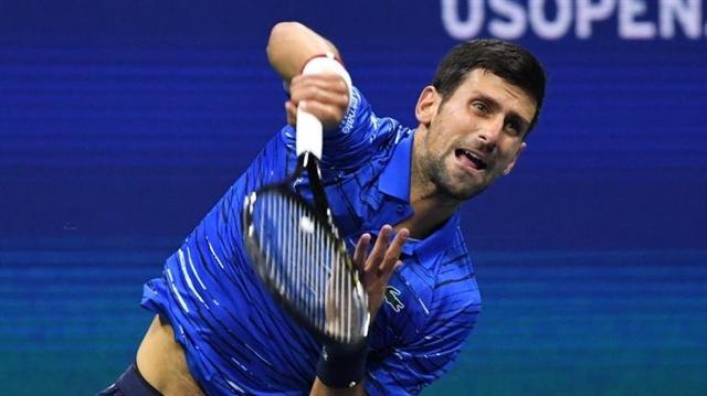 Hurting Djokovic slow-starting Federer win at rain-hit US Open