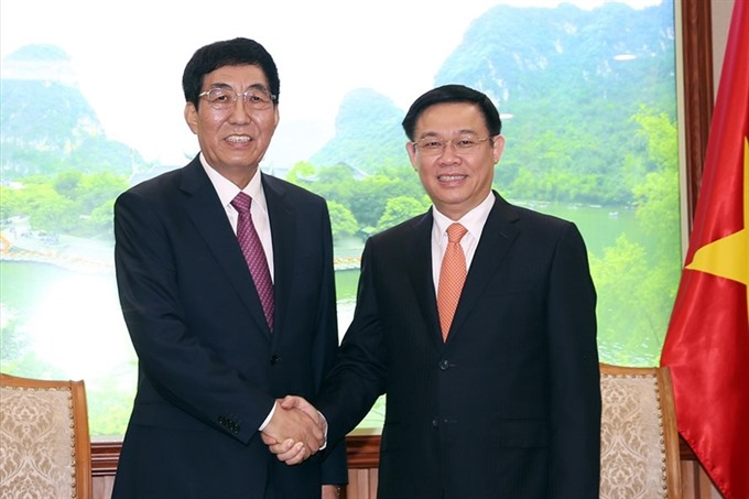 Deputy PM Vương Đình Huệ welcomes Party chief of Chinese province
