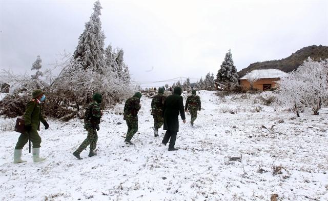 Mountain border turn white with snow border guards work harder