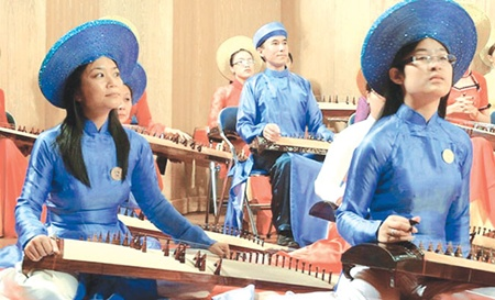Performing overseas: Members of the Huong Viet Traditional Music Group, founded by doctor Hong Viet Hai, perform dan tranh at an international zitherist festival held last month in HCM City.