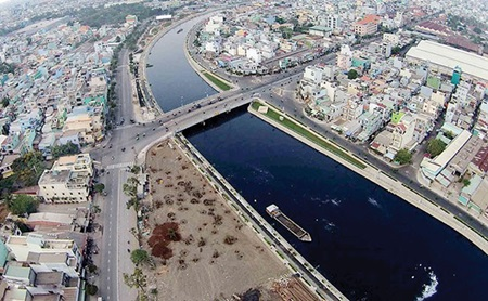 A photo shows the new look of a stretch of Tan Hoa - Lo Gom Canal after the canal underwent a comprehensive clean-up in HCM City.