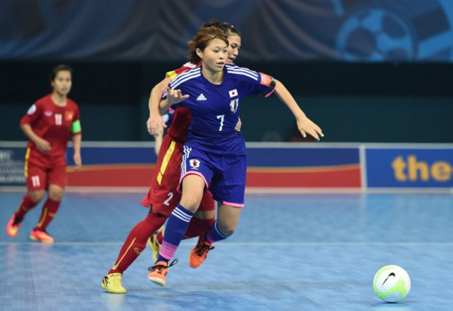 I got this  Japan and Viet Nam s players vie for the ball in Group B match  of the AFC Women s Futsal Championship in Nilai e883846efa1d0