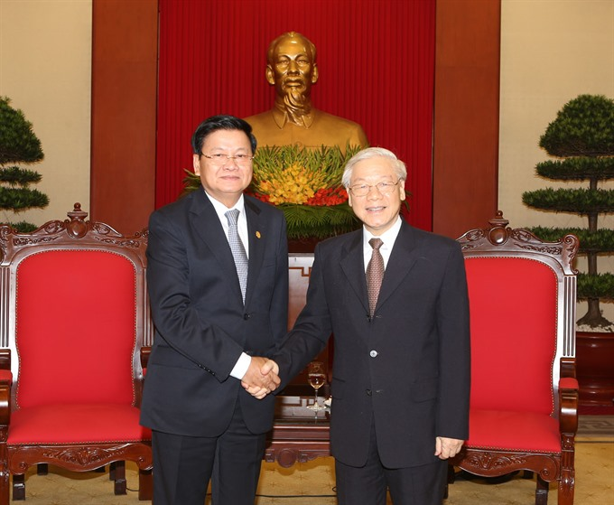 Party General Secretary hosts Lao Prime Minister