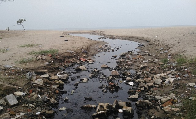 Sewage ditches discharging waste water on beach