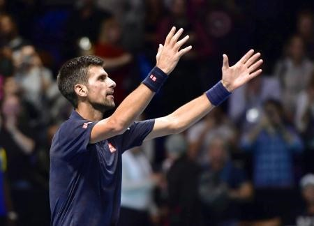 Gritty Djokovic avoids Thiem upset at Tour Finals