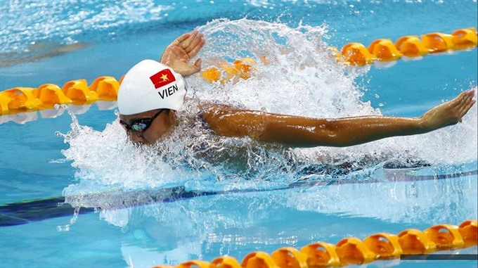 Viên wins gold sets Asian record in Tokyo