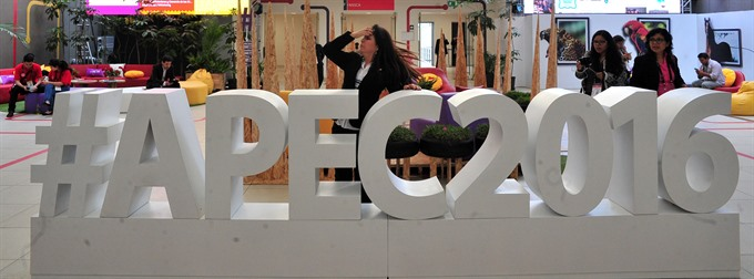 APEC vows to promote free trade over protectionism