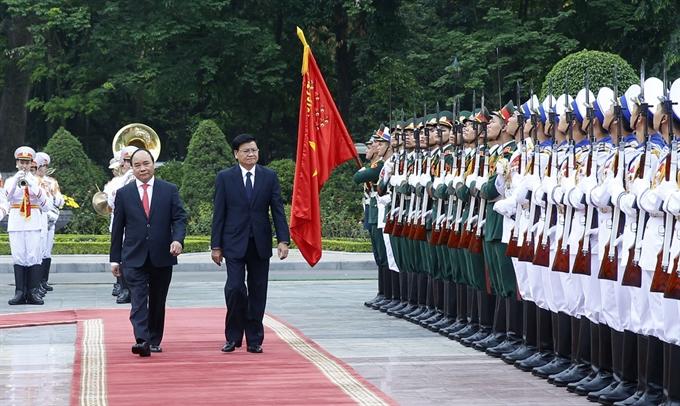 Vietnamese Lao PMs hold solidarity talks in Hà Nội