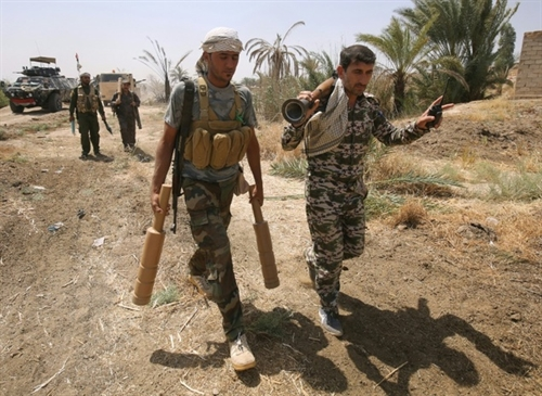 Twin assaults in Syria Iraq pile pressure on IS