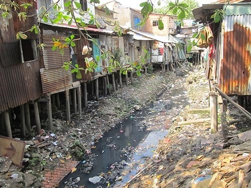 Canal litter blocking HCM City water flow