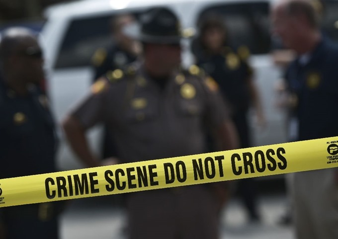 Three injured in US school shooting after teen suspect kills father