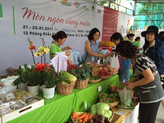 Tết market selling safe farm produce opens in HCM City