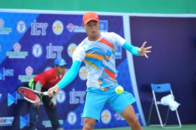 Tuấn wins mens singles national title