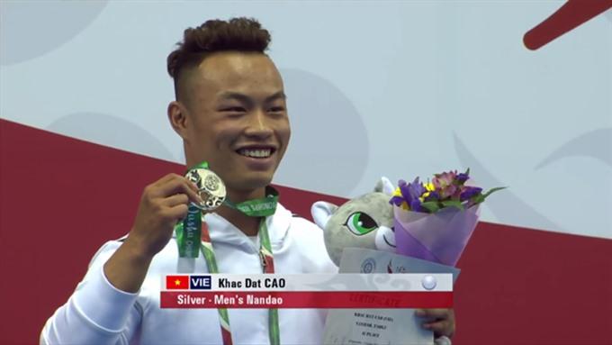 Đạt brings home a world wushu silver