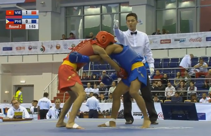 Wushu fighter finds gold after 16 years for VN