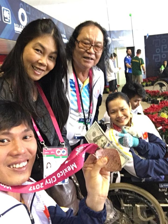 Swimmer Tùng wins bronze at Mexican world champs