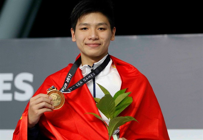 Teen swims his way to success