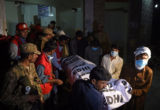 Islamic State-claimed bomb kills 70 at Pakistan shrine