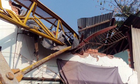 Two people injured in crane collapse