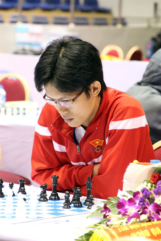 Huy tops mens event at national chess meet