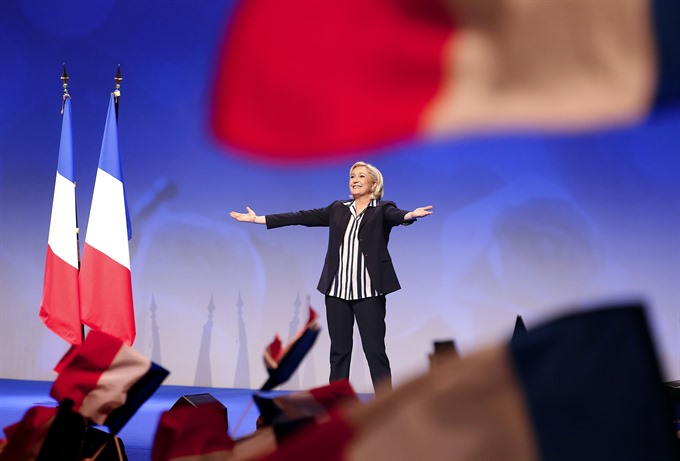 Le Pen says voters must choose for or against France