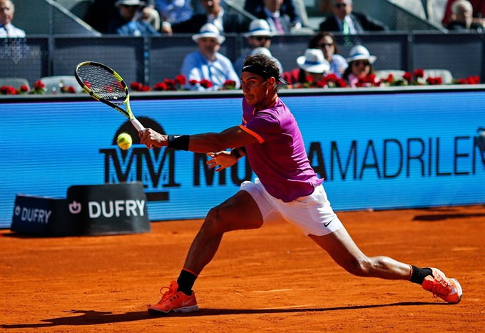Djokovic Nadal struggle in Madrid openers