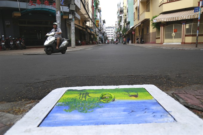 Through the lens - Manhole covers as art: students beautify the streets